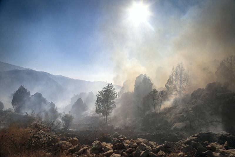 Smoke rises from a forest in Jird Meshmesh, in Lebanon's Akkar region on Aug. 24, 2020. Khaled Taleb for The National