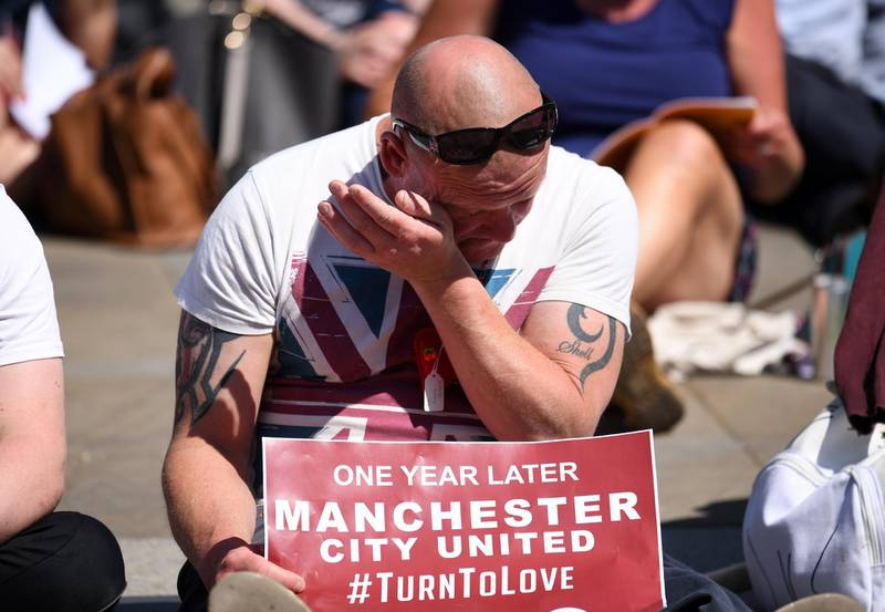 MANCHESTER, ENGLAND - MAY 22:  A man wipes tears away as he watches the outside broadcast of The Manchester Arena National Service of Commemoration at Manchester Cathedral on May 22, 2018 in Manchester, England. Twenty-two people were killed and hundreds injured when Salman Abedi detonated a bomb at the end of an Ariana Grande concert at Manchester Arena on 22 May 2017.  (Photo by Leon Neal/Getty Images)