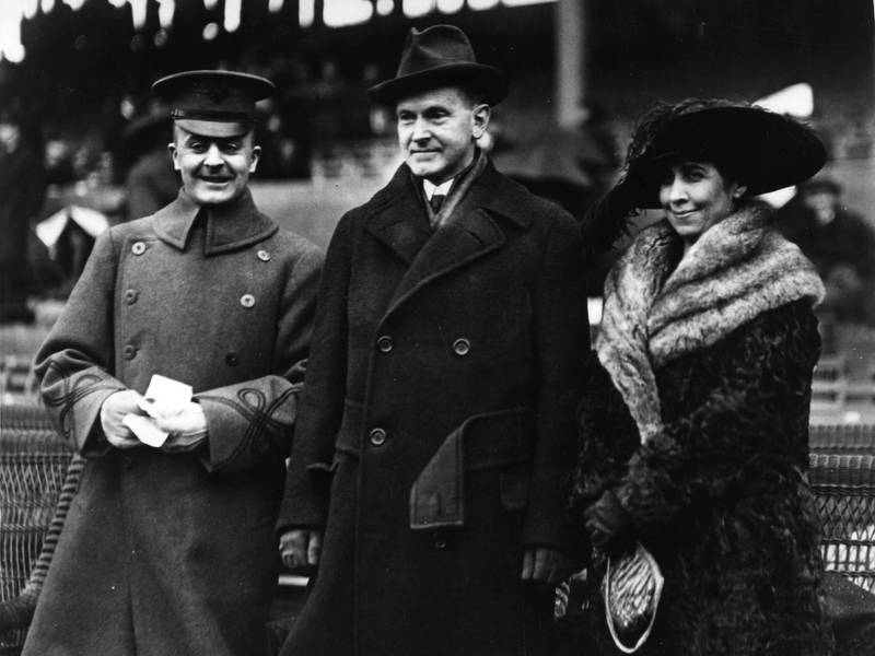 American Vice-President Calvin Coolidge (1872 - 1933), later the 30th President of the United States, Captain Charles A Mahoney and Grace Coolidge watch the Navy Eleven play West Point at American football.  Original Publication: People Disc - HC0449   (Photo by Hulton Archive/Getty Images)