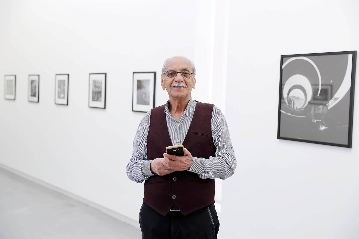 SHARJAH , UNITED ARAB EMIRATES , MARCH 15  – 2017 :- Latif Al Ani , artist with his work during the opening of the exhibition at Sharjah Art Foundation in Sharjah. ( Pawan Singh / The National ) For Arts & Life. Story by Melissa