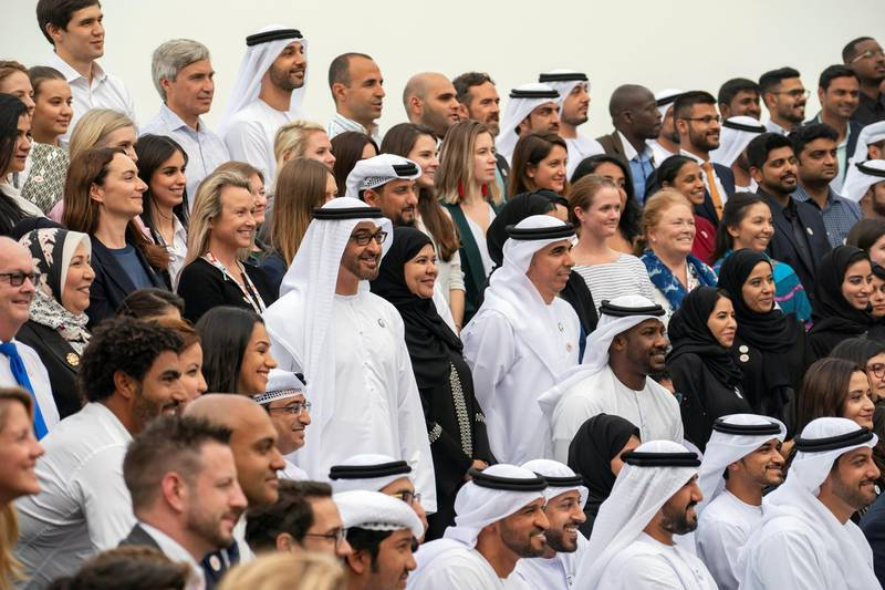 ABU DHABI, UNITED ARAB EMIRATES - March 25, 2019: HH Sheikh Mohamed bin Zayed Al Nahyan, Crown Prince of Abu Dhabi and Deputy Supreme Commander of the UAE Armed Forces (C), stands for a photograph with members of the Special Olympics World Games Abu Dhabi 2019 Higher Committee and organizers, during a Sea Palace barza. Seen with Majid Al Usaimi, National Director of the Special Olympics UAE.  ( Ryan Carter / Ministry of Presidential Affairs ) ---