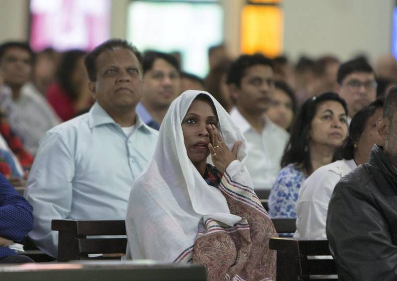 DUBAI, UNITED ARAB EMIRATES - Worshippers are emotional upon seeing the Pope on the screen at St. Mary's Church, Oud Mehta.  Leslie Pableo for The National for Nick Webster's story