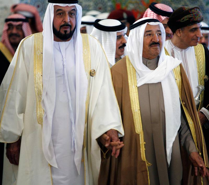 Kuwaiti leader, Sheikh Sabah al-Ahmad al-Sabah (R), arrives with UAE president, Sheikh Khalifa bin Zayed al-Nahayan (L), at the final session of the Gulf Cooperation Council (GCC) summit in Kuwait City on December 15, 2009. Leaders of the energy-rich Gulf states ended a two-day summit by voicing confidence over the ability of their economies to overcome the impact of the global economic crisis. AFP PHOTO/YASSER AL-ZAYYAT (Photo by YASSER AL-ZAYYAT / AFP)