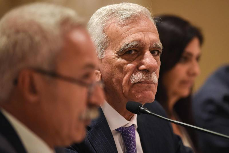 The removed mayor of Mardin, Ahmet Turk (C), looks over during a foreign media press conference with the removed mayor of Diyarbakir, Adnan Selcuk Mizrakli (L) on August 29, 2019, in Istanbul. The Turkish government removed three pro-Kurdish mayors from office over alleged links to Kurdish militants as Ankara deepened its crackdown on the opposition.  The mayors of Diyarbakir, Mardin and Van provinces in eastern Turkey -- all members of the pro-Kurdish Peoples' Democratic Party (HDP) elected in March -- were suspended on August 19,  over alleged ties to the outlawed Kurdistan Workers' Party (PKK). / AFP / BULENT KILIC