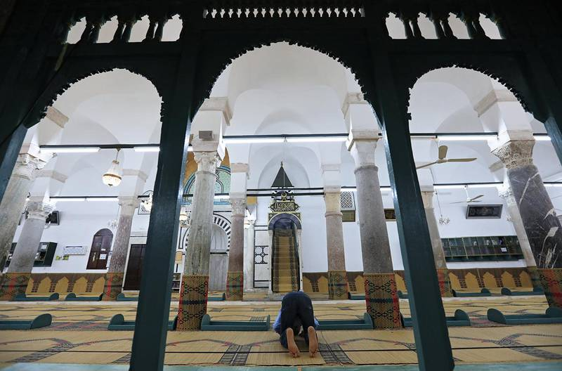 A man prays at a mosque on the first day of Ramadan in Tunis, Tunisia, May 17, 2018. REUTERS/Zoubeir Souissi