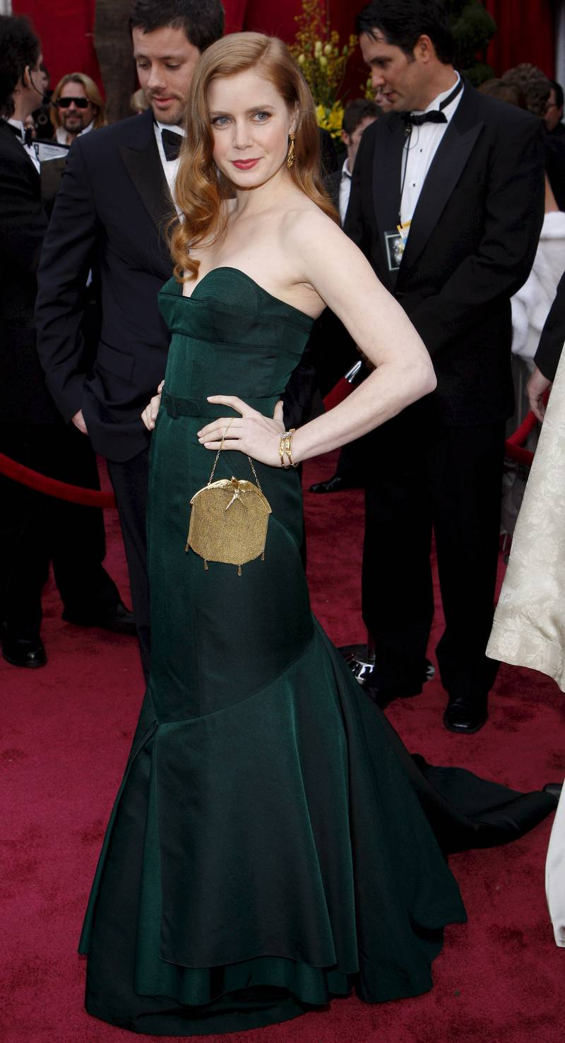 epa01265939 US actress Amy Adams arrives for the 80th annual Academy Awards at the Kodak Theatre in Hollywood, California, USA, 24 February 2008. The Academy Awards, popularly known as the Oscars, are presented by the Academy of Motion Picture Arts and Sciences (AMPAS) to recognize excellence of professionals in the film industry, including directors, actors, and writers.  EPA/ANDREW GOMBERT