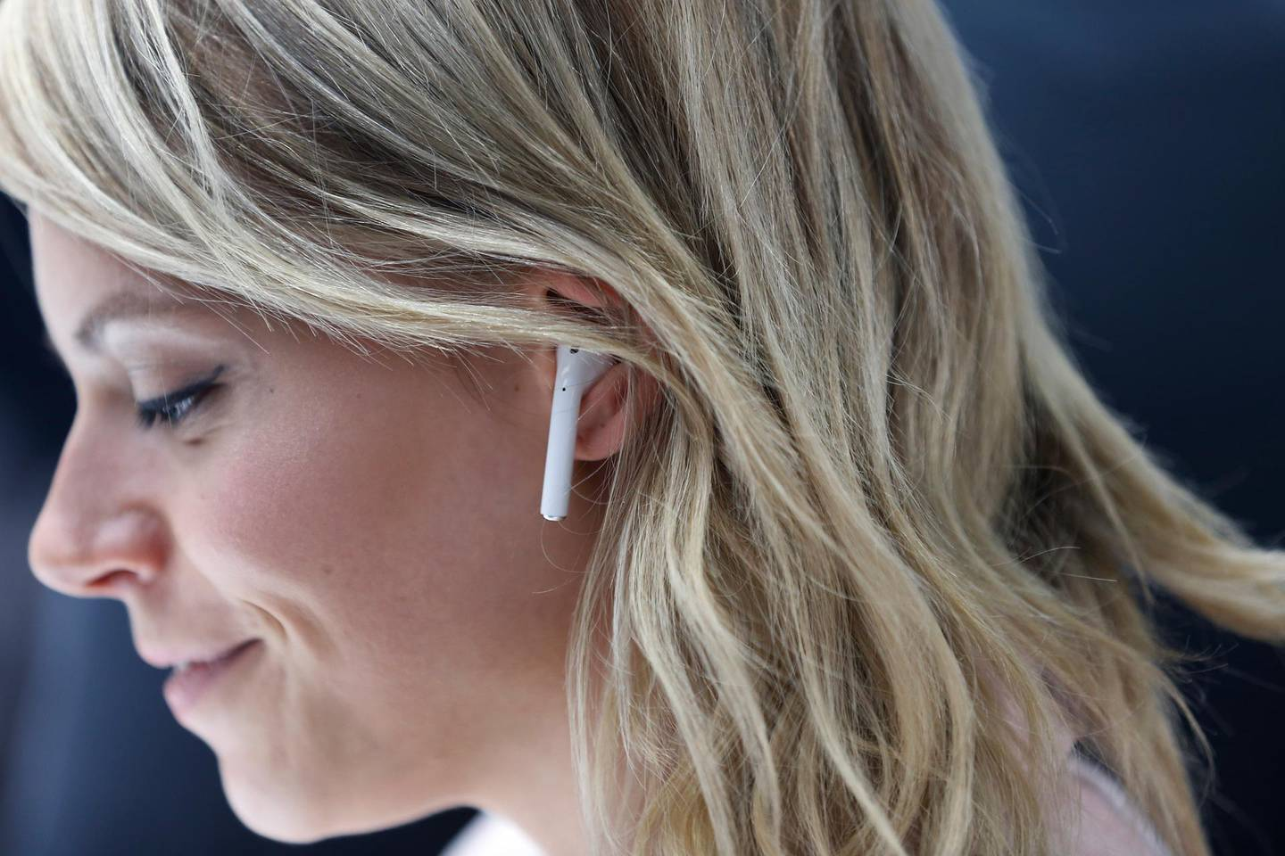 SAN FRANCISCO, CA - SEPTEMBER 07: An attendee wears an Apple AirPods during a launch event on September 7, 2016 in San Francisco, California. Apple Inc. unveiled the latest iterations of its smart phone, the iPhone 7 and 7 Plus, the Apple Watch Series 2, as well as AirPods, the tech giant's first wireless headphones.   Stephen Lam/Getty Images/AFP