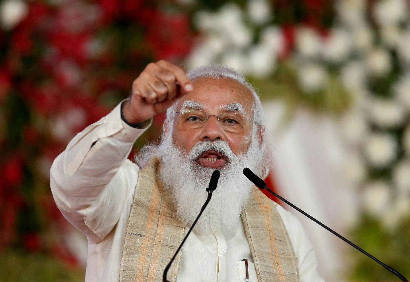 """FILE PHOTO: India's Prime Minister Narendra Modi addresses a gathering before flagging off the """"Dandi March"""", or Salt March, to celebrate the 75th anniversary of India's Independence, in Ahmedabad, India, March 12, 2021. REUTERS/Amit Dave/File Photo"""