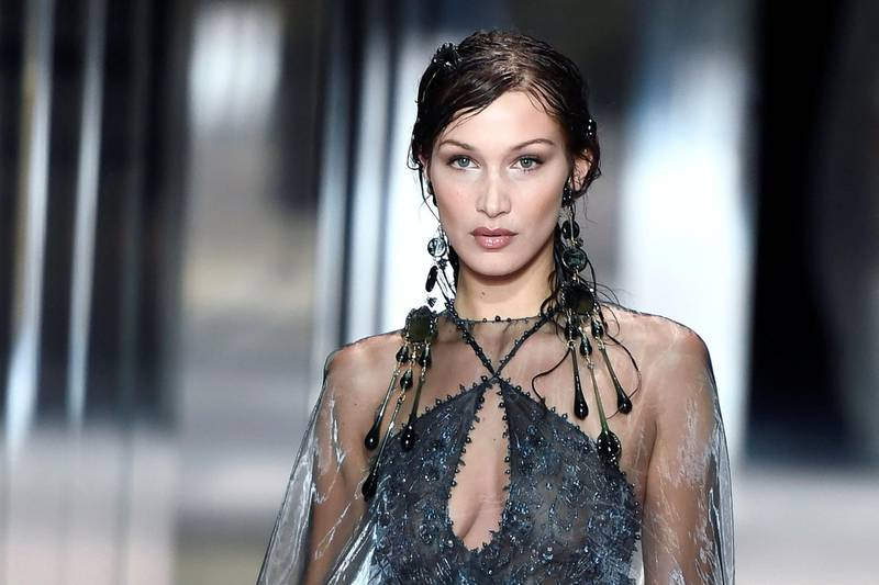 US model Bella Hadid presents a creation of British designer Kim Jones for the Fendi's Spring-Summer 2021 collection during the Paris Haute Couture Fashion Week, in Paris, on January 27, 2021. - British designer Kim Jones presents his first ever Couture Collection for Fendi since he joinded Italian fashion house Fendi as its lead designer for womenswear in September 2020. (Photo by STEPHANE DE SAKUTIN / AFP)