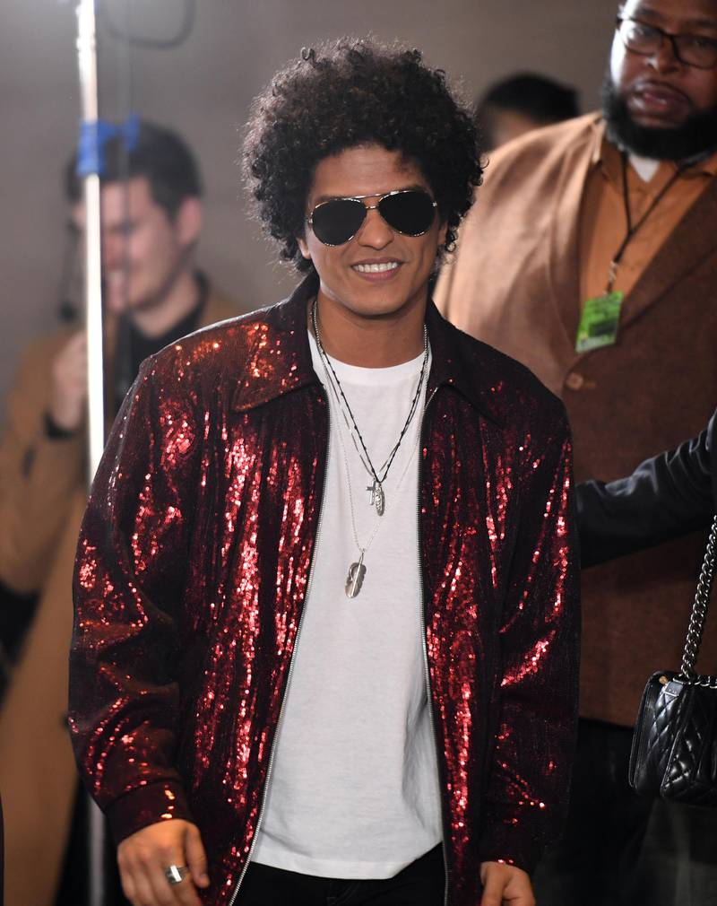 Singer Bruno Mars arrives in the press room during the 60th Annual Grammy Awards on January 28, 2018, in New York. / AFP PHOTO / Don EMMERT