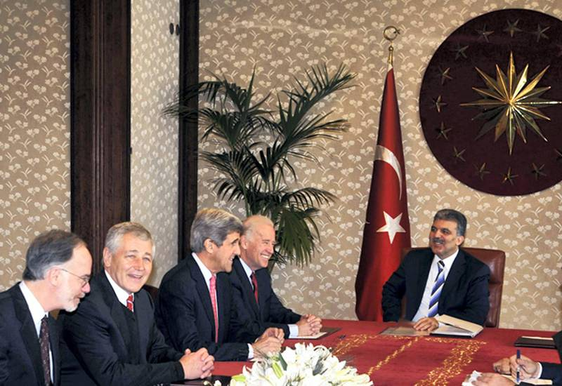 Turkish President Abdullah Gul (R) meets with US congressmen Joseph Biden (2ndR), John Kerry (C), Chuck Hagel (2ndL), and US Ambassador to Turkey Ross Wilson (L) in Ankara, on February 22, 2008. Turkish troops have launched a ground incursion across the border into Iraq in pursuit of separatist Kurdish rebels, the military said February 22, 2008 -- a move that dramatically escalates Turkey's conflict with the militants. AFP PHOTO/POOL/UMIT BEKTAS (Photo by UMIT BEKTAS / AFP)