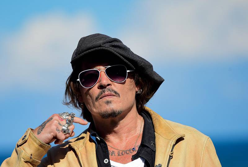 """FILE - In this file photo dated Sunday, Sept. 20, 2020, US actor and film producer Johnny Deep during the photocall for his film """"Crock of Gold: A Few Rounds with Shane Macgoman"""" at the 68th San Sebastian Film Festival, in San Sebastian, northern Spain.  In a letter to fans, Friday Nov.6, 2020, Depp said he had been """"asked to resign"""" from his role in the Fantastic Beasts film franchise, after losing a libel case labelling him a wife beater, a judgement he said he plans to appeal against. (AP Photo/Alvaro Barrientos, FILE)"""