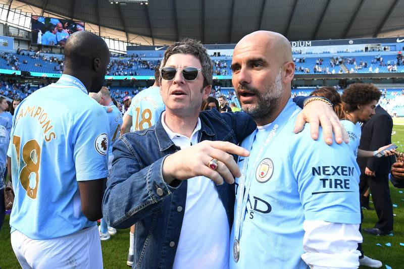 MANCHESTER, ENGLAND - MAY 06:  Noel Gallagher speaks to Josep Guardiola, Manager of Manchester City on the pitch after the Premier League match between Manchester City and Huddersfield Town at Etihad Stadium on May 6, 2018 in Manchester, England.  (Photo by Michael Regan/Getty Images)
