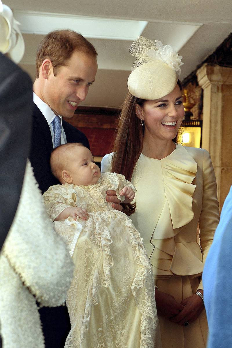 LONDON, ENGLAND - OCTOBER 23:  Prince William, Duke of Cambridge and Catherine, Duchess of Cambridge talk to Queen Elizabeth II (obscured) as they arrive, holding their son Prince George, at Chapel Royal in St James's Palace, ahead of the christening of the three month-old Prince George of Cambridge by the Archbishop of Canterbury on October 23, 2013 in London, England. (Photo by John Stillwell - WPA Pool /Getty Images)
