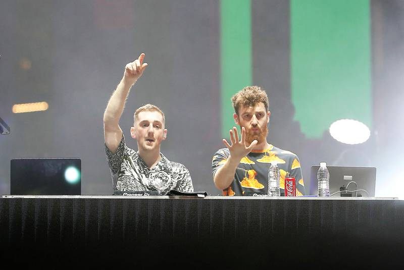 DUBAI , UNITED ARAB EMIRATES , December 18 – 2020 :- Members of the Clean Bandit DJ performing at the Burj Park in downtown Dubai on the second day of the DSF opening concert in Dubai.  ( Pawan Singh / The National ) For Arts & Culture/Online/Instagram. Story by Janice Rodrigues