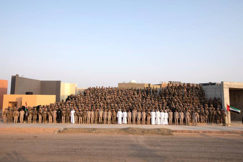 AL DHAFRA REGION, ABU DHABI, UNITED ARAB EMIRATES - June 26, 2019: HH Sheikh Theyab bin Mohamed bin Zayed Al Nahyan, Chairman of the Department of Transport, and Abu Dhabi Executive Council Member (front row 14th L), HE Lt General Hamad Thani Al Romaithi, Chief of Staff UAE Armed Forces (front row 22nd L), HRH Hussein bin Abdullah, Crown Prince of Jordan (front row 23rd L), HM King Abdullah II, King of Jordan (front row 24th L), HH Sheikh Mohamed bin Zayed Al Nahyan, Crown Prince of Abu Dhabi and Deputy Supreme Commander of the UAE Armed Forces (front row 25th L), HH Sheikh Tahnoon bin Mohamed Al Nahyan, Ruler's Representative in Al Ain Region (front row 26th L), HE Brigadier General Saleh Mohamed Saleh Al Ameri, Commander of the UAE Ground Forces (front row 28th L), HH Sheikh Diab bin Tahnoon bin Mohamed Al Nahyan (front row 32nd L), HE Mohamed Mubarak Al Mazrouei, Undersecretary of the Crown Prince Court of Abu Dhabi (front row 33rd L), HH Sheikh Mohamed bin Hamad bin Tahnoon Al Nahyan (front row 34th L) and HH Sheikh Zayed bin Mohamed bin Hamad bin Tahnoon Al Nahyan (front row 35th L), stand for a photograph with members of the UAE Armed Forces and the Jordanian Armed Forces, after a joint military drill, Titled 'Bonds of Strength', at Al Hamra Camp.  ( Rashed Al Mansoori / Ministry of Presidential Affairs ) ---