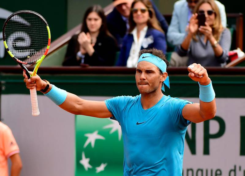 epa06771148 Rafael Nadal of Spain reacts after winning against Simone Bolelli of Italy during their men's first round match during the French Open tennis tournament at Roland Garros in Paris, France, 29 May 2018.  EPA/CAROLINE BLUMBERG