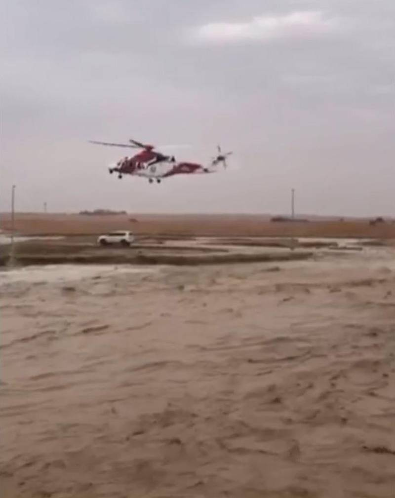 A screenshot of the video showing the NSRC helicopter was able to land on the small island in the middle of the Wadi where Emirati man and his wife  were trapped and the team managed to evacuate them to safety. National Center for Search and Rescue said the centre received a call around 3pm about an Emirati man and his wife being surrounded by floods after their car got stuck in a wadi located in Al Bateen area in Al Ain Wadis on Saturday. Courtesy NSRC