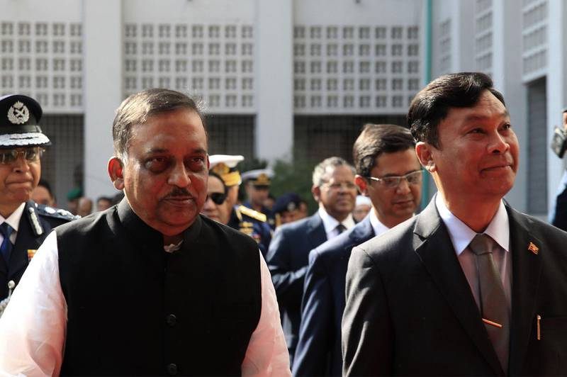 Myanmar home minister Gen Swe (R) and his Bangladesh counterpart Asaduzzaman Khan (L) looks on in Dhaka on February 16, 2018. Bangladesh February 16 handed over a list of more than 8,000 Rohingya to Myanmar as it moves to kick-start their repatriation weeks after the process was halted due to lack of preparation.  / AFP PHOTO / -