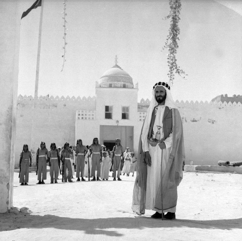 Sheikh Shakhbut Bin Sultan Al Nahyan standing in front of Qasr Al Hosn. ©National Archives.