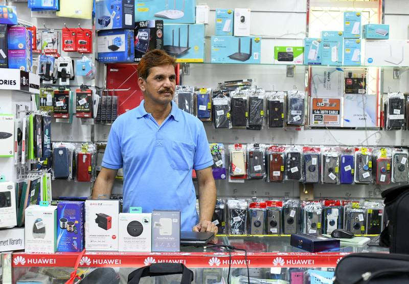 Residents and Heat in Sweihan-AD  Haris Hassan, 50, from Kerala owner of Mega Fun Electronics, and resident of Sweihan on June 9, 2021. Reporter: Haneen Dajani News