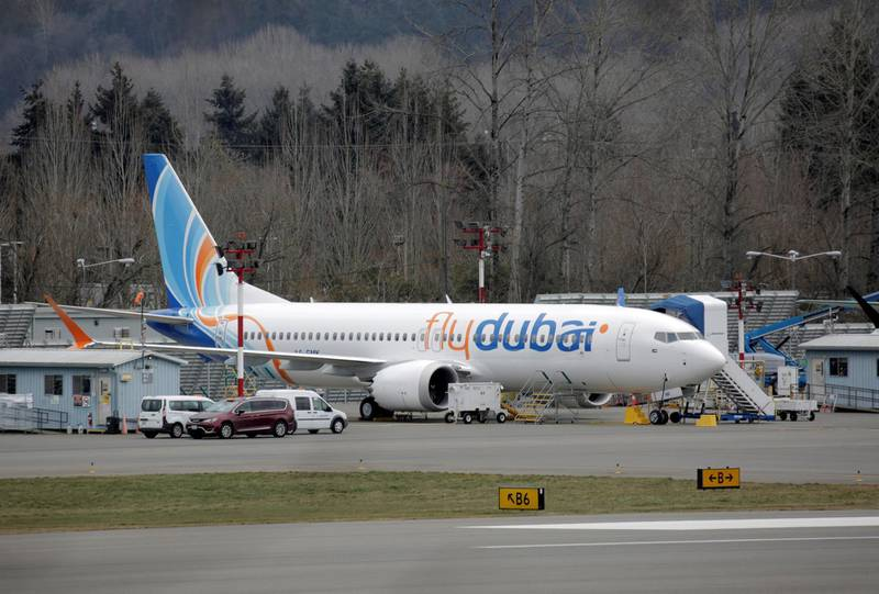 FILE PHOTO: A Boeing 737 MAX aircraft bearing the logo of flydubai is parked at a Boeing production facility in Renton, Washington, U.S. March 11, 2019. REUTERS/David Ryder/File Photo
