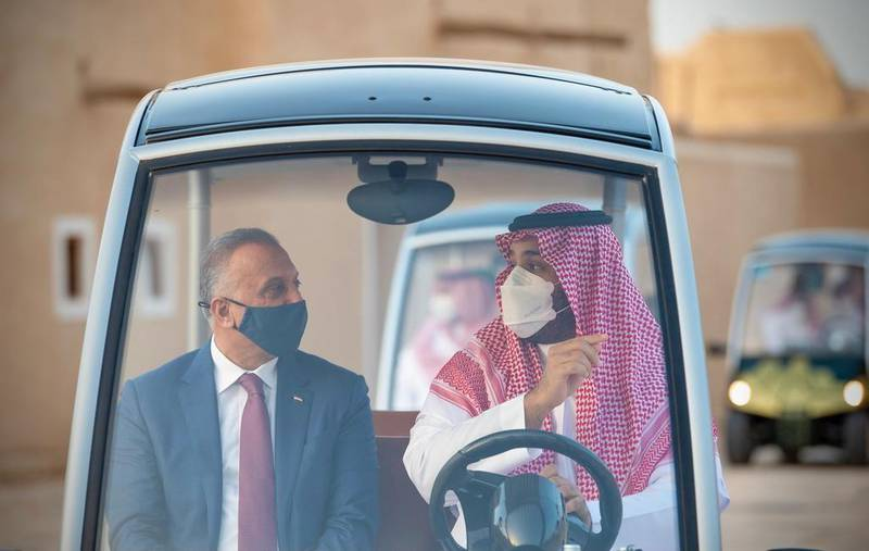 Saudi Arabia's Crown Prince Mohammed bin Salman and Iraqi Prime Minister Mustafa Al-Kadhimi, visit the historical city Ad Diriyah on the outskirts of Riyadh, Saudi Arabia March 31, 2021. Bandar Algaloud/Courtesy of Saudi Royal Court/Handout via REUTERS ATTENTION EDITORS - THIS PICTURE WAS PROVIDED BY A THIRD PARTY