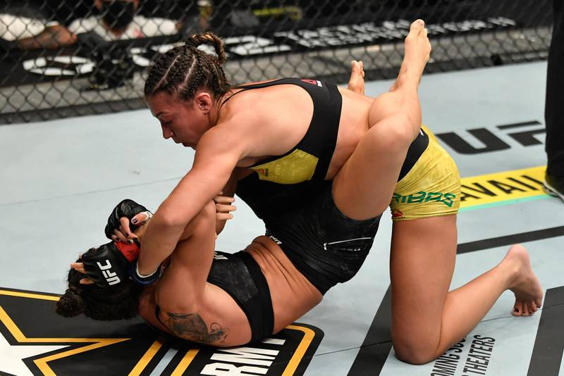 ABU DHABI, UNITED ARAB EMIRATES - JANUARY 23: In this handout image provided by the UFC, (R-L) Amanda Ribas of Brazil punches Marina Rodriguez of Brazil in a strawweight fight during the UFC 257 event inside Etihad Arena on UFC Fight Island on January 23, 2021 in Abu Dhabi, United Arab Emirates. (Photo by Jeff Bottari/Zuffa LLC via Getty Images)