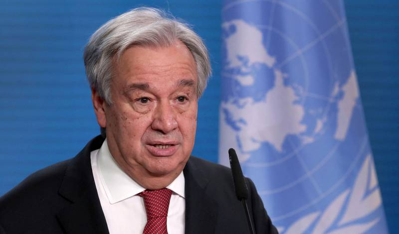 """(FILES) In this file photo UN Secretary-General Antonio Guterres attends a joint press conference with the German Foreign Minister after a meeting in Berlin, on December 17, 2020.  The UN is in negotiations with Beijing for a visit """"without restrictions"""" to Xinjiang to see how the Uyghur minority is being treated, Secretary-General Antonio Guterres said in an interview broadcast on March 28, 2021. At least one million Uyghurs and people from other mostly Muslim groups have been held in camps in the northwestern region, according to US and Australian rights groups, which accuse Chinese authorities of forcibly sterilizing women and imposing forced labor.   / AFP / POOL / Michael Sohn"""