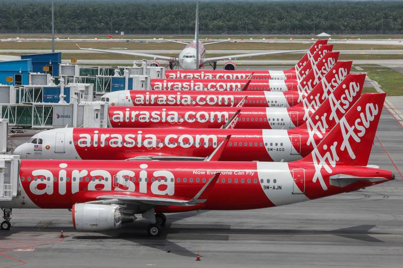 FILE PHOTO: AirAsia planes are seen parked at Kuala Lumpur International Airport 2, during the movement control order due to the outbreak of the coronavirus disease (COVID-19), in Sepang, Malaysia April 14, 2020. REUTERS/Lim Huey Teng/File Photo