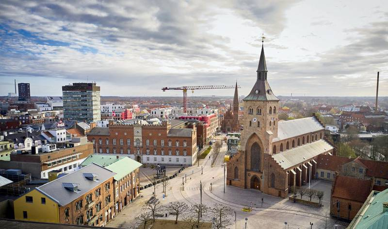 Aerial view of the St. Canute's Cathedral (Sankt Knud Kirke) in Odense, the birthplace of Swedish writer Hans Christian Andersen, on April 9, 2020, Denmark, in the early morning during the novel coronavirus COVID-19 lockdown. (Photo by Mikkel Berg Pedersen / Ritzau Scanpix / AFP) / Denmark OUT