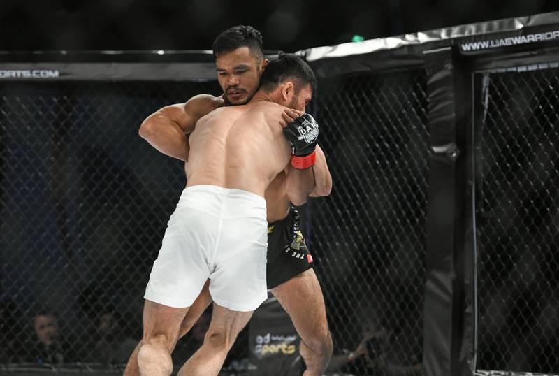 Abu Dhabi, United Arab Emirates - The feather-weight round Rolando Dy from the Philippines vs. Yerzhan Yestanov from Kazakhstan at the UAE Warriors MMA event at the Mubadala Arena, Zayed Sports City. Khushnum Bhandari for The National