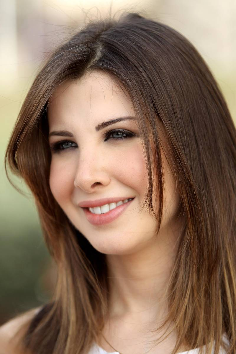 DUBAI, UNITED ARAB EMIRATES - MARCH 26:  Lebanese Singer and Unicef ambassadeur Nancy Ajram attends the Cartier International Dubai Polo Challenge at the Palm Desert Resort and Spa on March 26, 2010 in Dubai, United Arab Emirates.The annual event takes place under the patronage of HRH Princess Haya Bint Al Hussein, wife of HH Sheikh Mohammed Bin Rashid Al Maktoum, Vice President and Prime Minister of UAE Ruler of Dubai. The Cartier International Dubai Polo Challenge is the most celebrated tournament in the desert and one of three Cartier hosts each year including the Royal Cartier International Windsor Polo and Saint-Moritz Snow Polo event.  (Photo by Chris Jackson/Getty Images for Cartier)