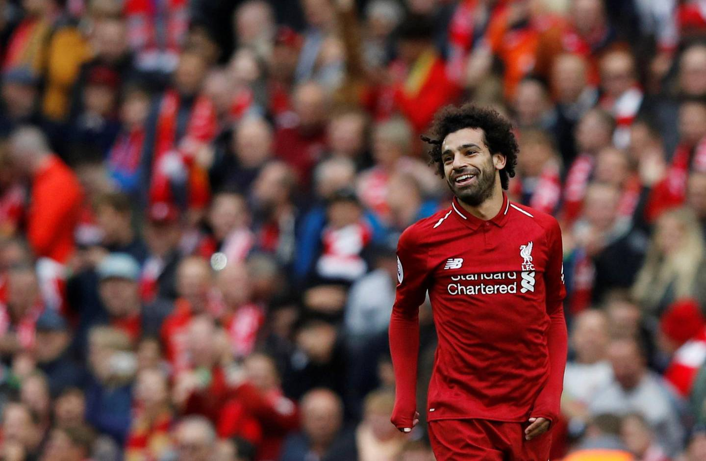 """Soccer Football - Premier League - Liverpool v Southampton - Anfield, Liverpool, Britain - September 22, 2018  Liverpool's Mohamed Salah celebrates scoring their third goal   REUTERS/Phil Noble  EDITORIAL USE ONLY. No use with unauthorized audio, video, data, fixture lists, club/league logos or """"live"""" services. Online in-match use limited to 75 images, no video emulation. No use in betting, games or single club/league/player publications.  Please contact your account representative for further details."""