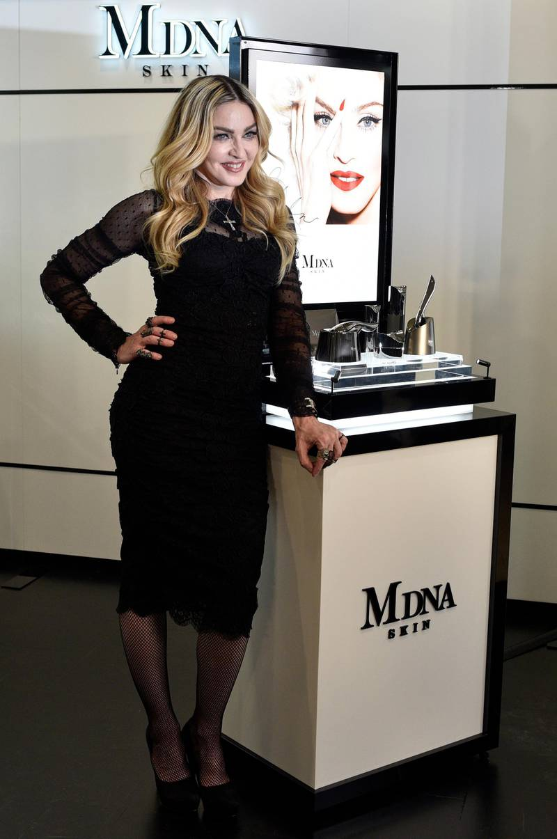 epa05162509 US singer, songwriter and actress Madonna poses during a promotional event in Tokyo, Japan, 15 February 2016. The event was to promote 'MDNA SKIN' skin care brand, a cosmetic line created by Madonna in collaboration with MTG.  EPA/FRANCK ROBICHON