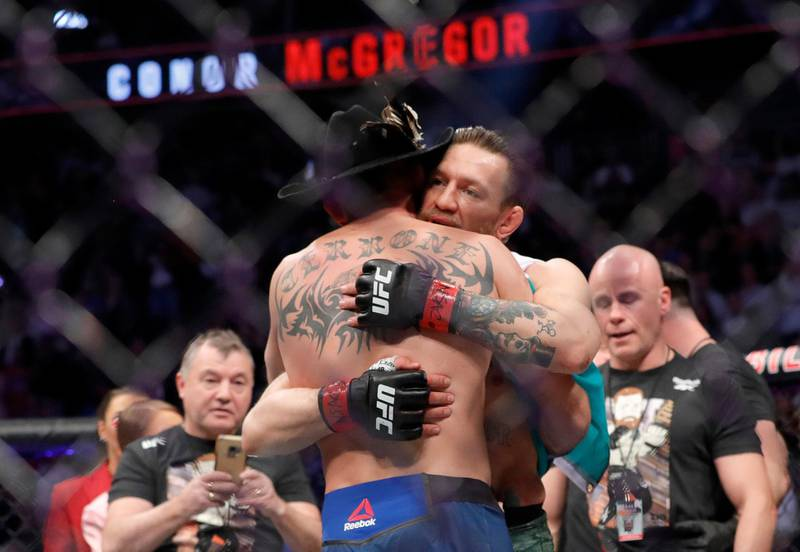 LAS VEGAS, NEVADA - JANUARY 18: Conor McGregor hugs Donald Cerrone after his first round TKO victory in their welterweight bout during UFC246 at T-Mobile Arena on January 18, 2020 in Las Vegas, Nevada.   Steve Marcus/Getty Images/AFP