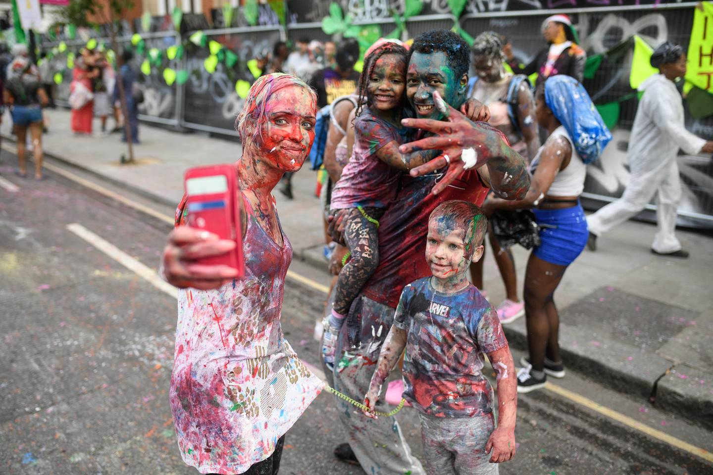 """LONDON, ENGLAND - AUGUST 27:  Paint-covered revellers take part in the traditional """"J'ouvert"""" opening parade of the Notting Hill carnival on August 27, 2017 in London, England.  (Photo by Leon Neal/Getty Images)"""