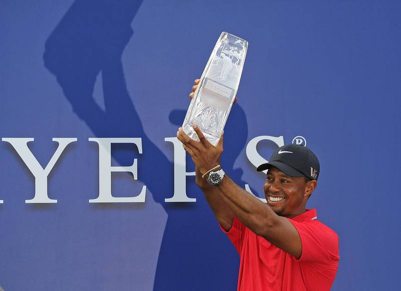 PONTE VEDRA BEACH, FL - MAY 12: Tiger Woods poses with the tournament trophy after winning THE PLAYERS Championship on THE PLAYERS Stadium Course at TPC Sawgrass on May 12, 2013 in Ponte Vedra Beach, Florida. (Photo by Chris Condon/PGA TOUR/Getty Images)