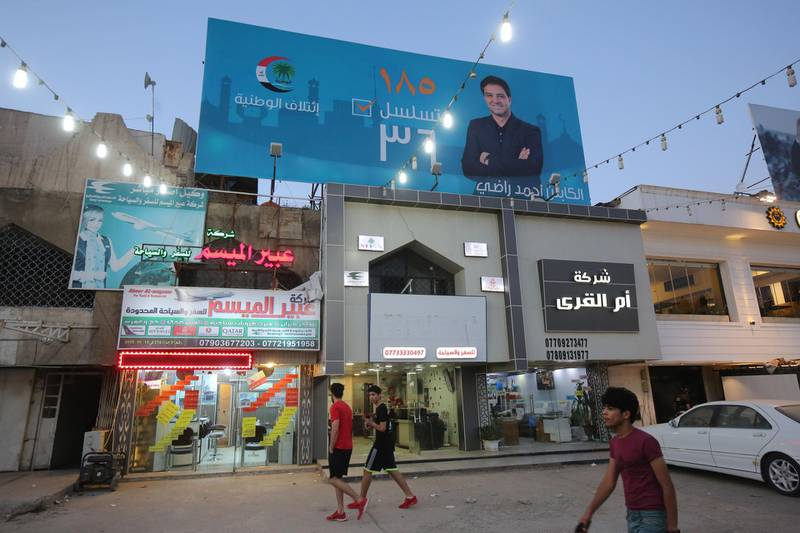 A picture taken on April 23, 2018, shows the campaign poster of Ahmed Radhi , a former Iraqi footballer, hanging in a street in Baghdad. / AFP PHOTO / AHMAD AL-RUBAYE
