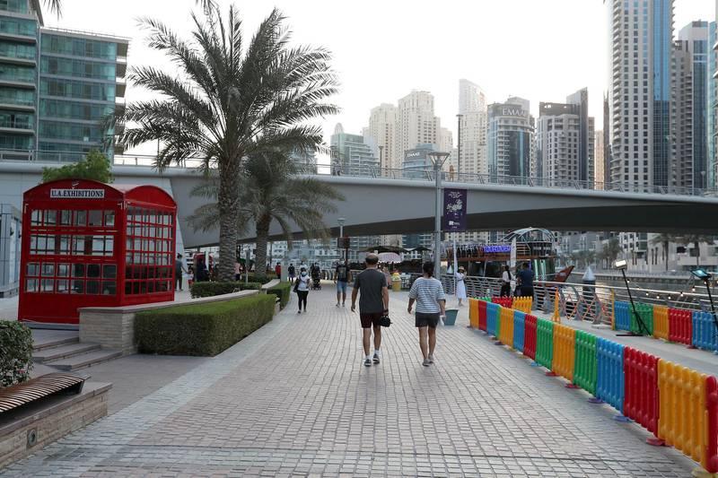 DUBAI, UNITED ARAB EMIRATES , October 12 – 2020 :- View of the marina walk in Dubai Marina in Dubai. (Pawan Singh / The National) For Stock