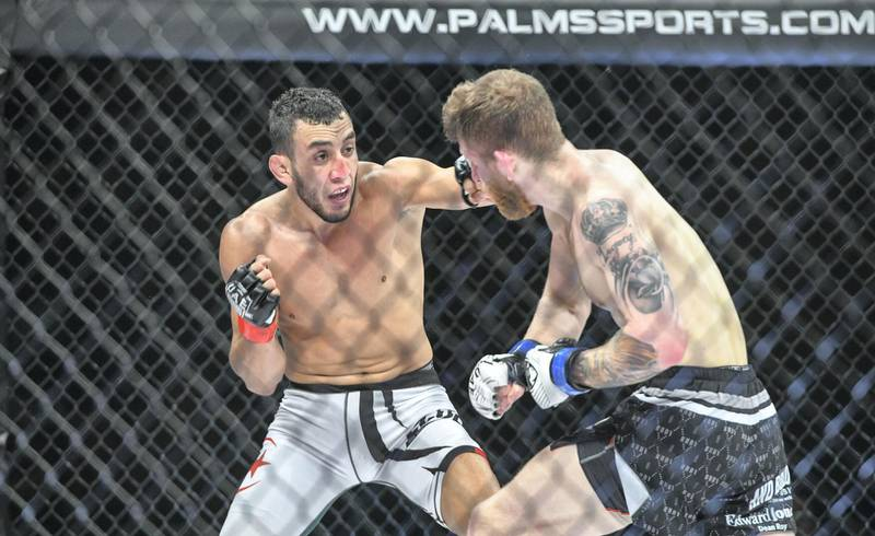 Abu Dhabi, United Arab Emirates - Elias Boudegzoame from Algeria defeats Austin Arnett, from United States in the feather weight for UAE Warriors Fighting Championship at Mubadala Arena, Zayed Sports City. Khushnum Bhandari for The National