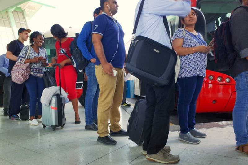 <p>UAE residents line up at the bus terminal in Abu Dhabi waiting for buses to Dubai as they head out of town as the EID holiday weekend starts. &nbsp;Delores Johnson&nbsp;/ The National&nbsp;</p>