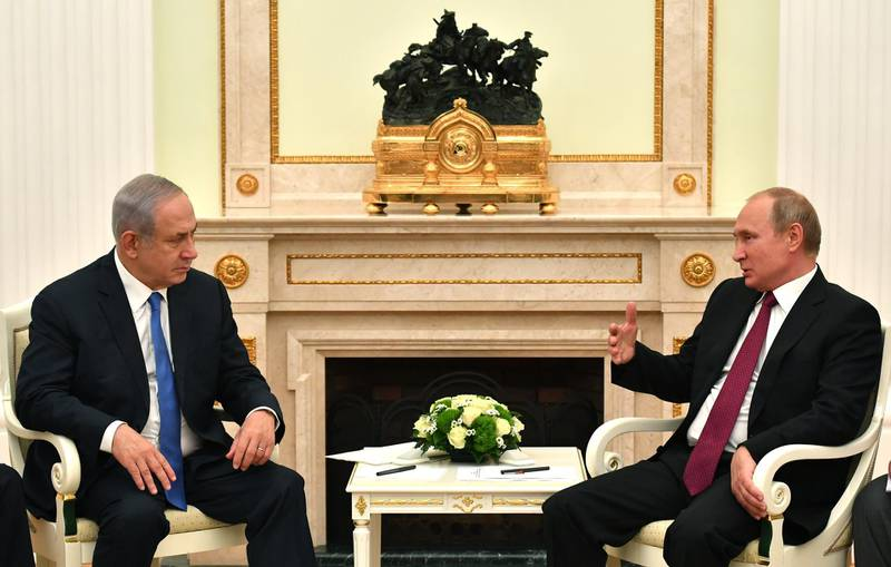 epa06881271 Russian President Vladimir Putin (R) speaks with Israeli Prime Minister Benjamin Netanyahu (L) during their meeting at the Kremlin in Moscow, Russia, 11 July 2018. The leaders meet to discuss bilateral cooperation and international issues, including Palestinian-Israeli settlement and the situation in Syria.  EPA/YURI KADOBNOV/POOL