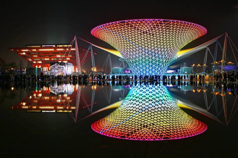 SHANGHAI, CHINA - MAY 01:  The night scene at the China Pavilion (L) and the Expo Axis  (R) on the opening day of the Shanghai World Expo on May 1, 2010 in Shanghai, China. Shanghai World Expo will be held from May 1 to Oct 31, expecting 70 million visitors.  (Photo by Feng Li/Getty Images)