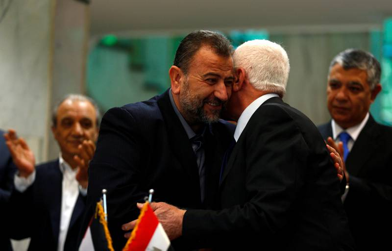 Head of Hamas delegation Saleh Arouri hugs Fatah leader Azzam Ahmad as they sign a reconciliation deal in Cairo, Egypt, October 12, 2017. REUTERS/Amr Abdallah Dalsh