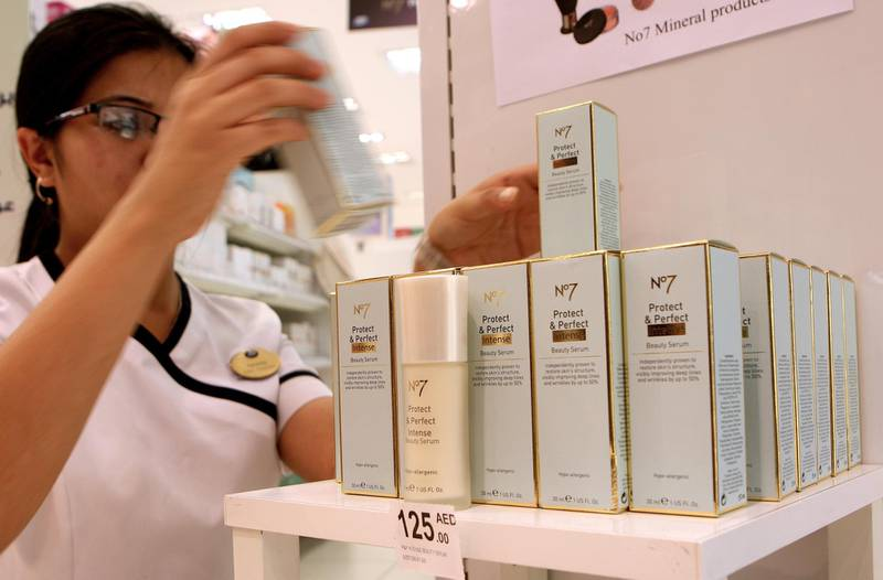 DUBAI - MAY 29,2009 - Store assistant arrange the No 7. Protect and Perfect Intense Beauty serum in the shelf at Boots health and cosmetics shop at IBN Batuta mall. ( Paulo Vecina /The National ) *** Local Caption ***  PV Face Cream 4.jpg