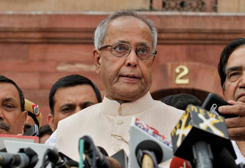 FILE PHOTO: Pranab Mukherjee speaks to media in the run-up to the Indian presidential election in New Delhi June 26, 2012. REUTERS/Adnan Abidi/File Photo