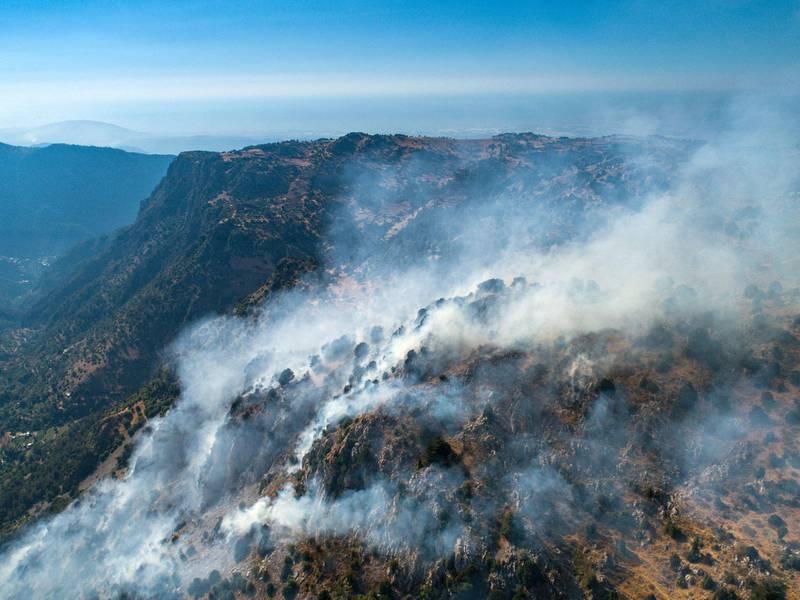 Smoke rises above Jird Meshmesh, in Lebanon's Akkar region on Aug. 24, 2020. Khaled Taleb for The National