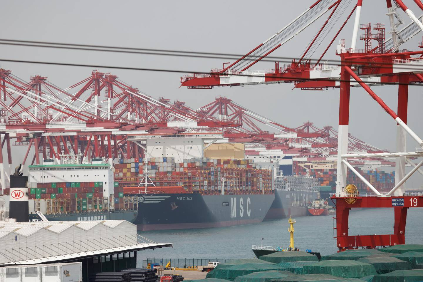 Container ships are seen at Qingdao port in Shandong province, China, following an oil spill in the Yellow Sea caused by a collision between tanker A Symphony and bulk vessel Sea Justice off the port, April 28, 2021. REUTERS/Carlos Garcia Rawlins