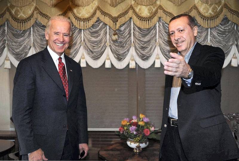 """US Vice President Joe Biden (L) poses with Turkish Prime Minister Tayyip Erdogan on December 3, 2011 during a meeting in Istanbul. Biden visited Erdogan, who is recovering from a surgery last week.  AFP PHOTO / TURKISH PRIME MINISTER OFFICE / KAYHAN OZER RESTRICTED TO EDITORIAL USE - MANDATORY CREDIT """"AFP PHOTO / TURKISH PRIME MINISTER OFFICE / KAYHAN OZER"""" - NO MARKETING NO ADVERTISING CAMPAIGNS - DISTRIBUTED AS A SERVICE TO CLIENTS (Photo by KAYHAN OZER / TURKISH PRIME MINISTER OFFICE / AFP)"""